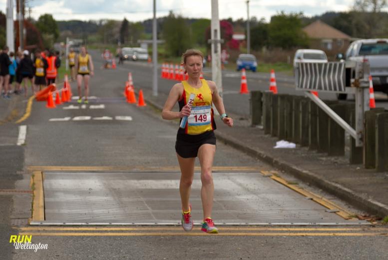 Wellington Scottish Senior Women's Captain Lindsay on her way to finish the last lap